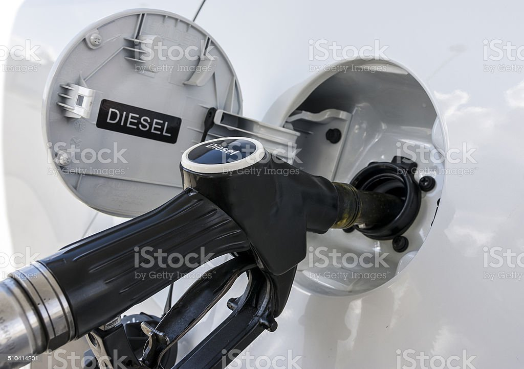Refueling the car with diesel close up illustration. stock photo