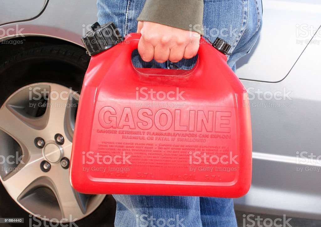 Refueling with a Red Gas Can stock photo