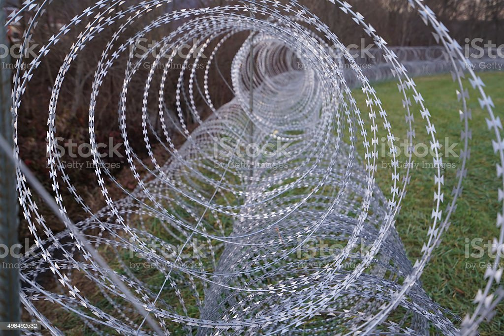 Refuge rezor wire as wormhole on border in Slovenia stock photo