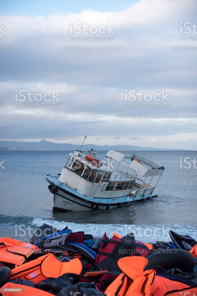 Refugee boat and lifejackets on Lesbos, Greece stock photo