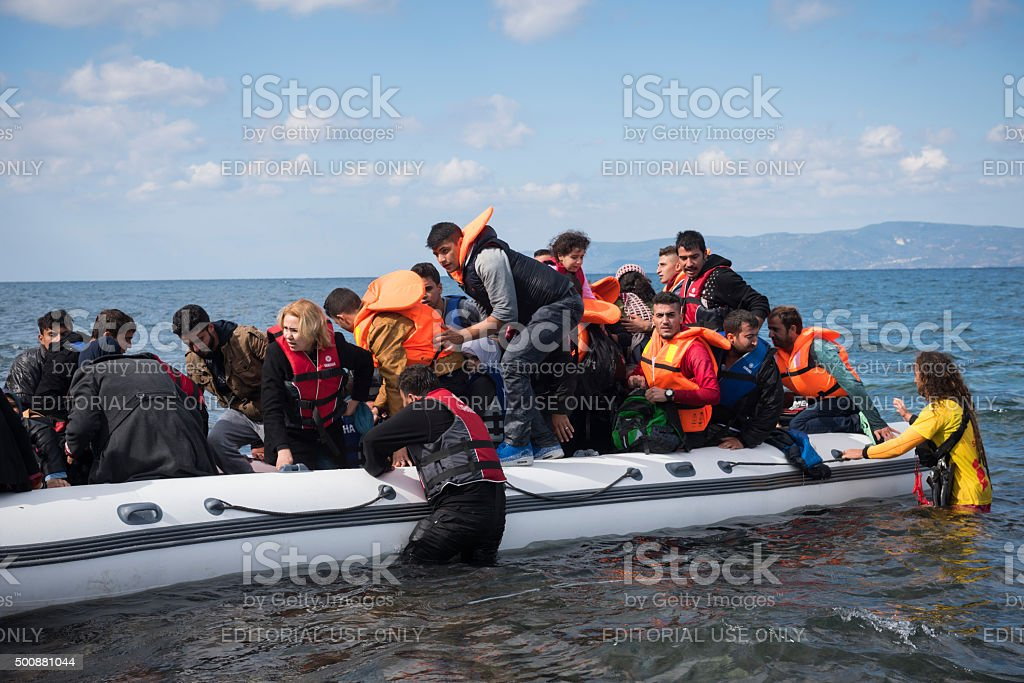 Refugee boat arriving on Lesbos Greece stock photo