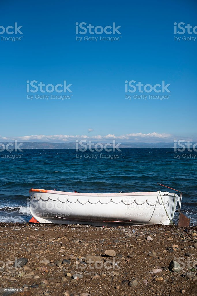 Refugee boat on Lesbos, Greece with Turkey in background stock photo