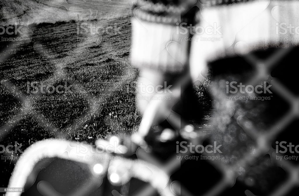 Refugee child goes with her suitcase behind the fence stock photo