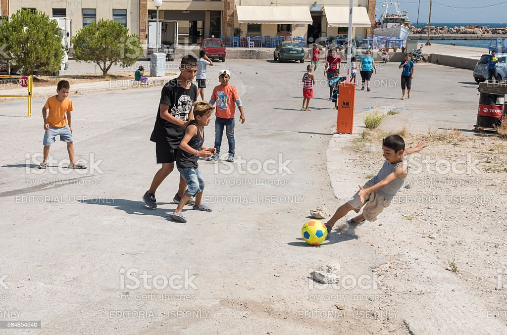 Refugee children and volunteers playing in Greek refugee camp stock photo
