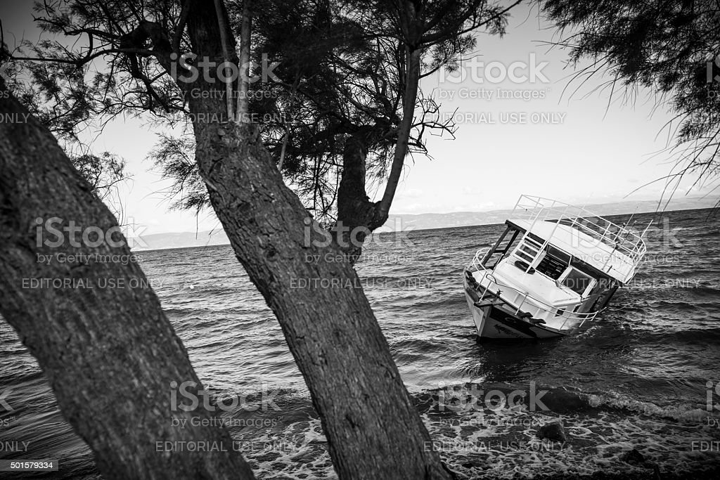 Refugee crisis in Europe - beached boat stock photo