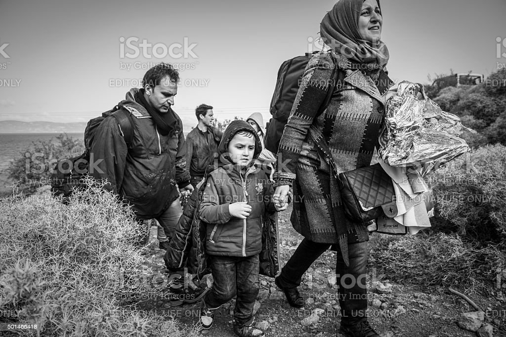 Refugee family arriving in Europe - Lesbos, Greece stock photo