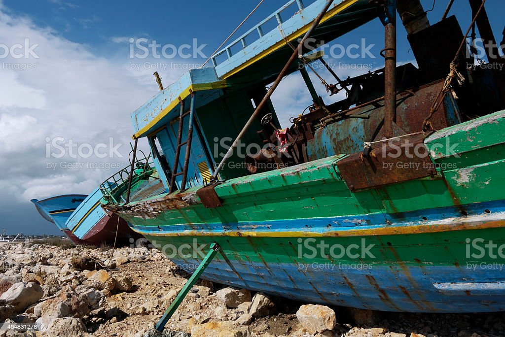Refugees boat cemetery stock photo