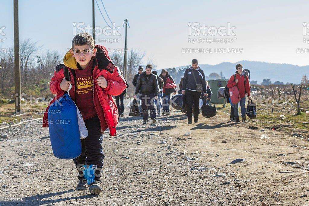 Refugees crossing the border between Greece and Macedonia in Gevgelija stock photo