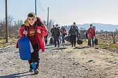 Refugees crossing the border between Greece and Macedonia in Gevgelija