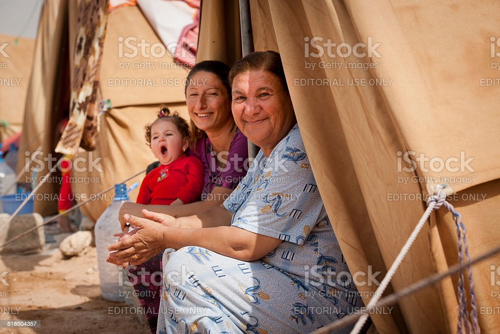 Refugees in front of their tent stock photo