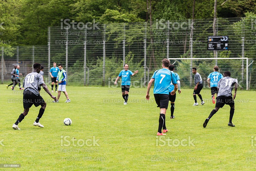Refugees playing soccer stock photo