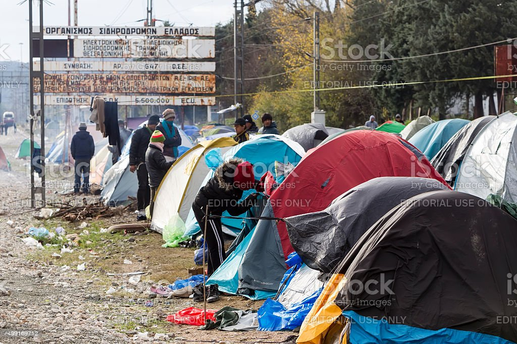 Refugees wait at the border between Greece and FYROM stock photo