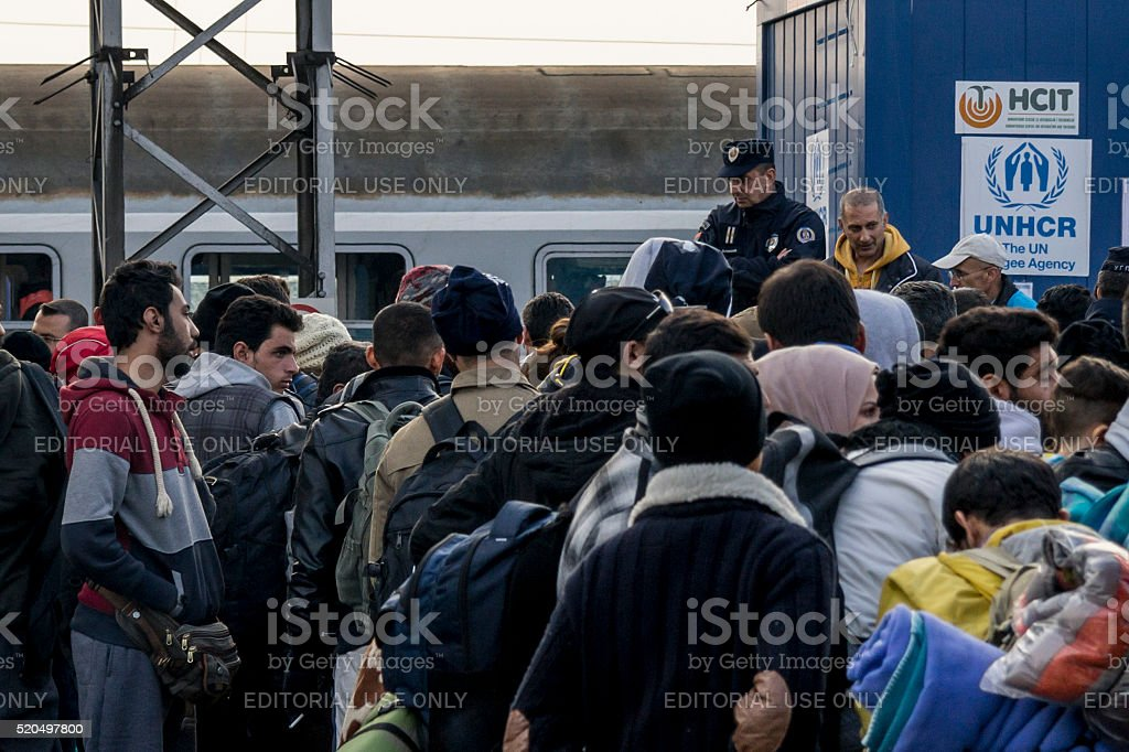 Refugees waiting to board a train on the Serbia-Croatia border stock photo