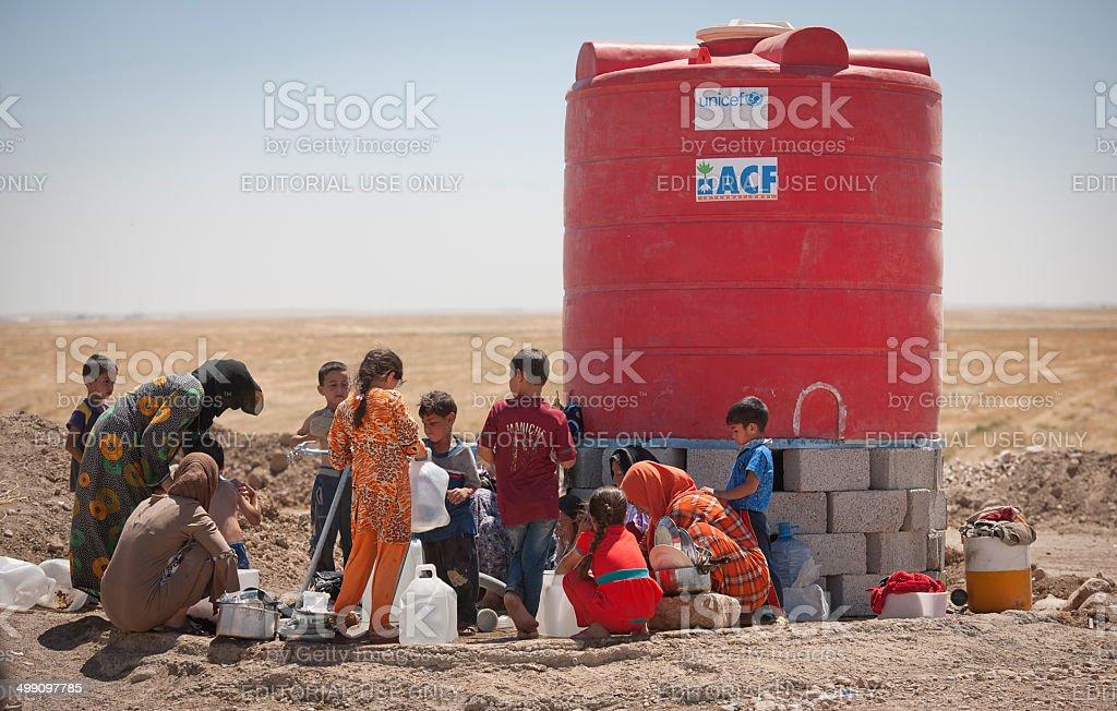 Refugees washing cloth stock photo