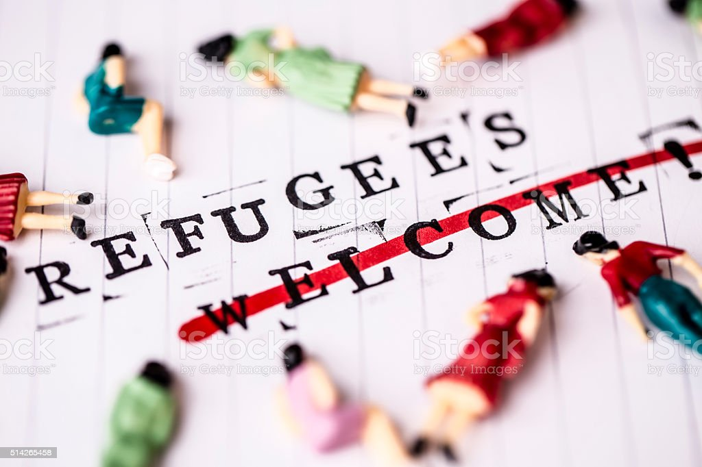 refugees welcome strikethrough text on paper stock photo