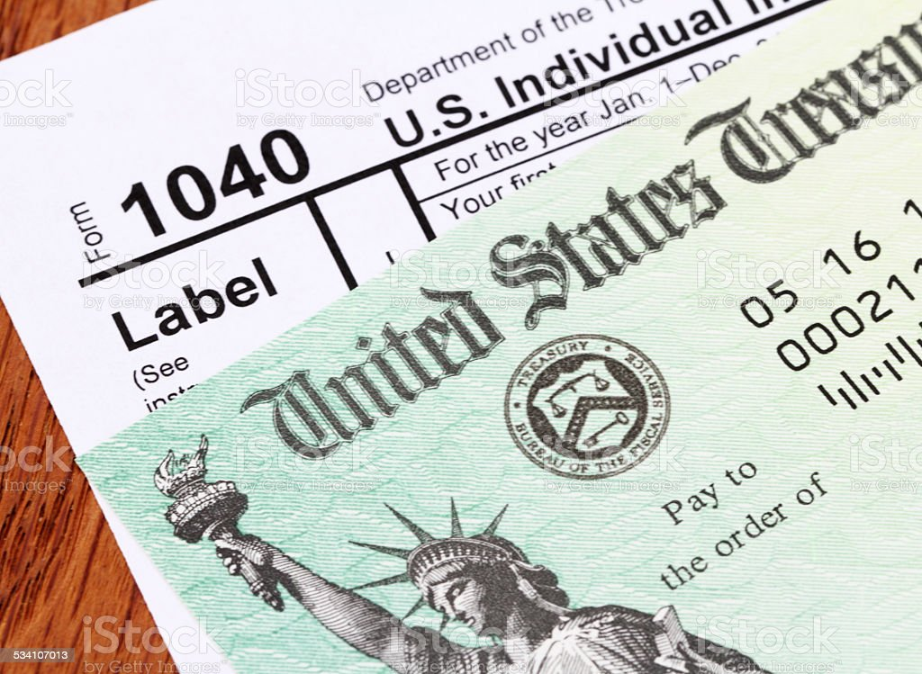 IRS refund check and 1040 tax form stock photo