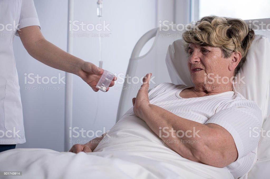 Refusing to take medicine stock photo