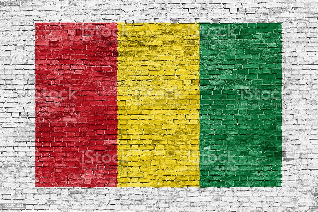Reggae colors painted over brick wall stock photo