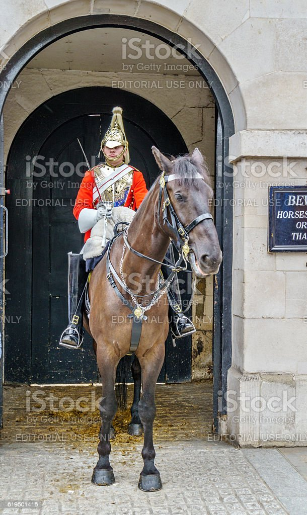 Regimental soldier with sword on horse stock photo