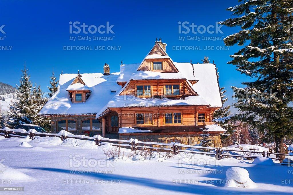Regional style buildings in winter, Zakopane, Poland stock photo