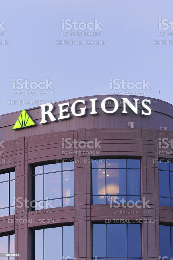 Regions bank sign on building at dusk stock photo