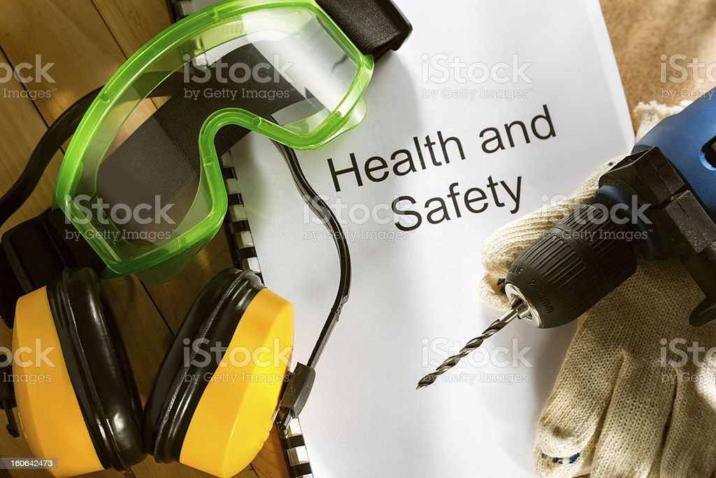 Register with goggles, drill and earphones stock photo