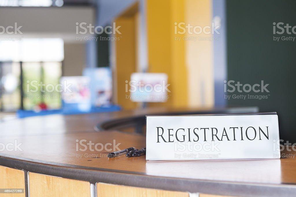 Registration sign on desk in modern office lobby stock photo