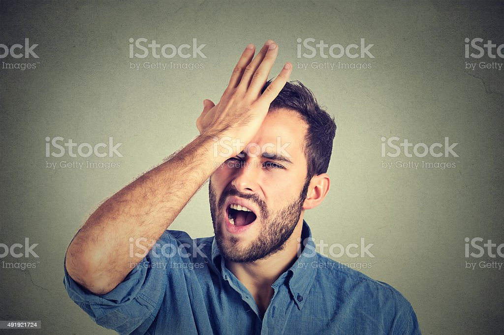 Regrets wrong doing. Man having a duh moment stock photo