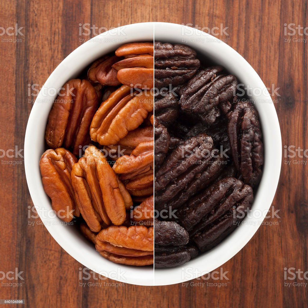 Regular and candied pecans composition stock photo