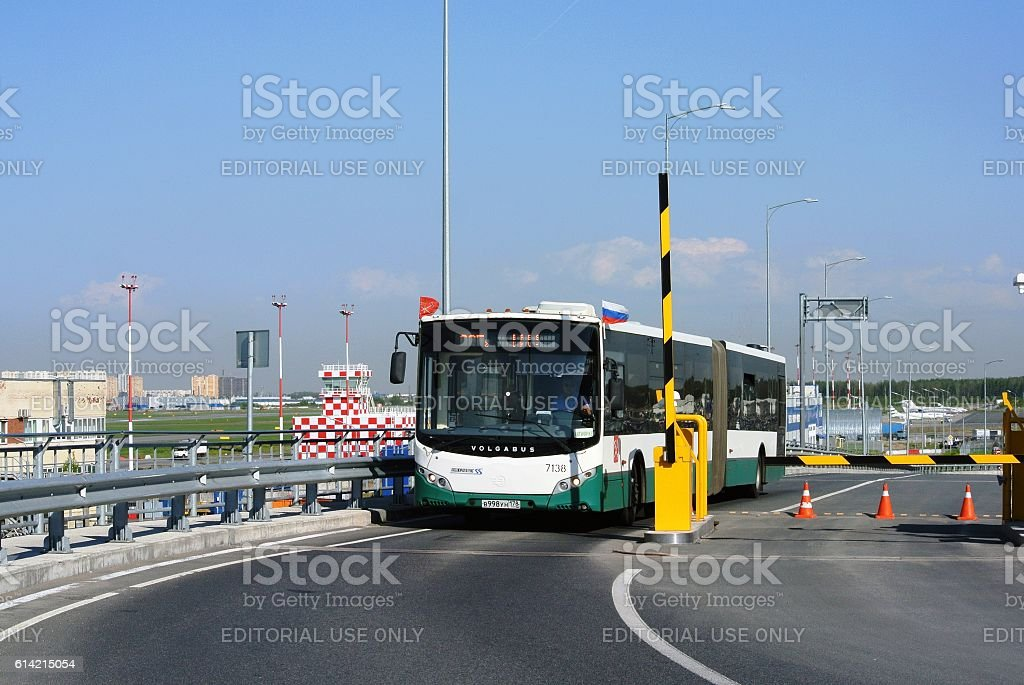 Regular bus passengers crossing zone checkpoint in airport stock photo