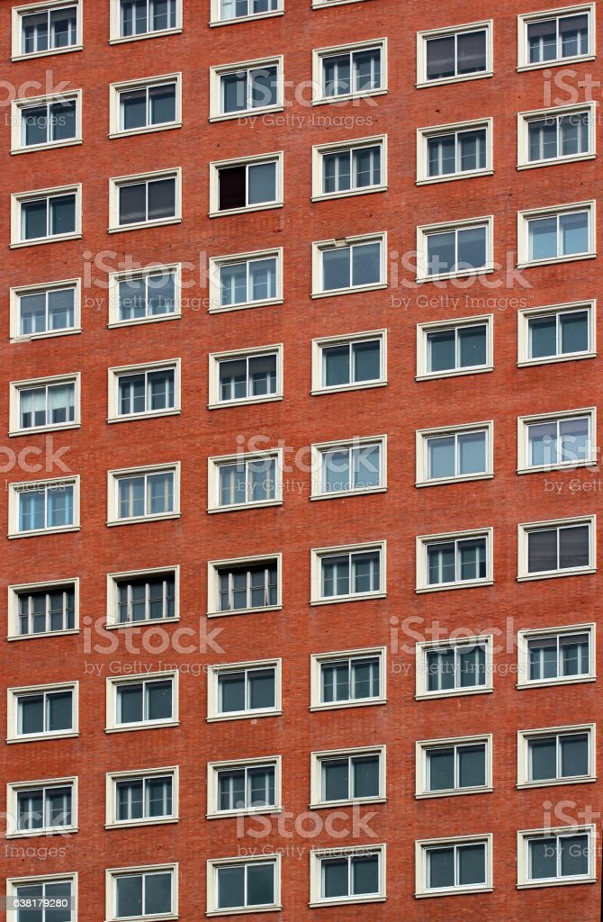 Regular pattern of windows in a modern building stock photo