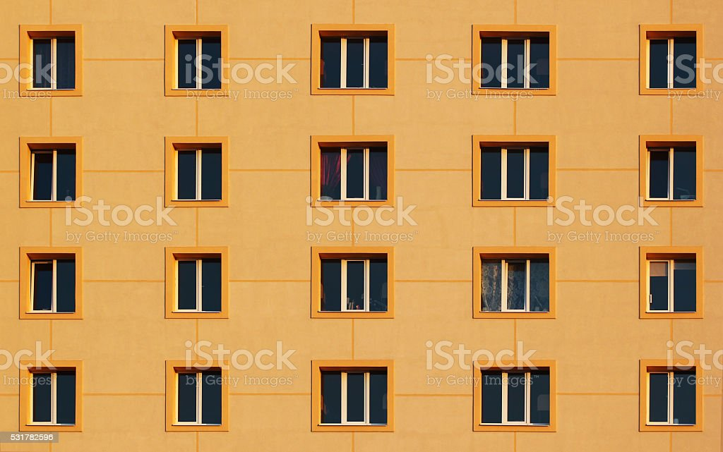 Regular pattern of windows in modern residential building. stock photo