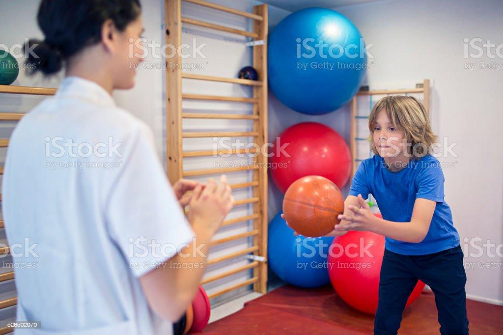 Rehabilitation exercises with ball stock photo