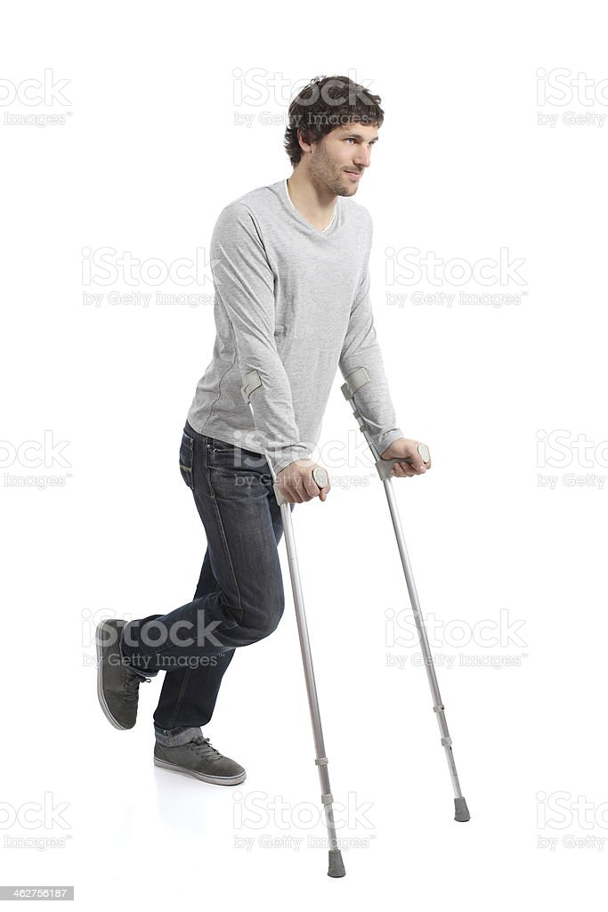 Rehabilitation of an adult man walking with crutches stock photo
