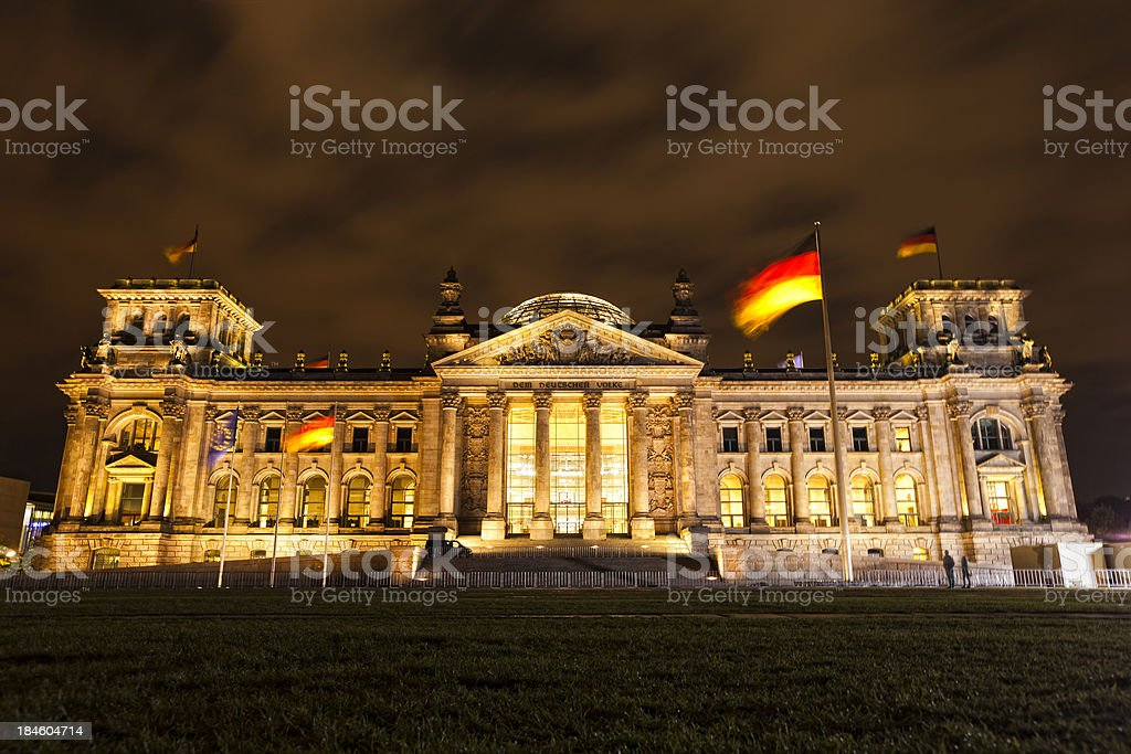 Reichstag building of German parliament by night stock photo