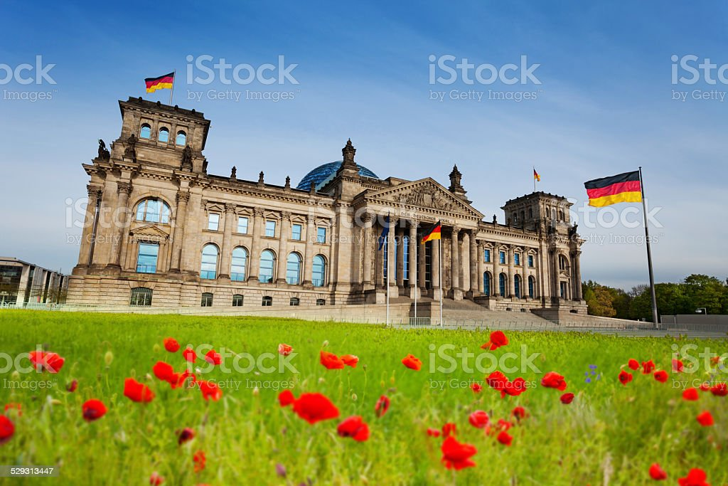 Reichstag view with red tulips and German flags stock photo