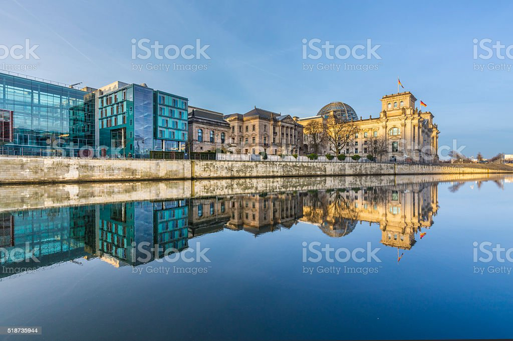 Reichstag with reflection in river Spree stock photo