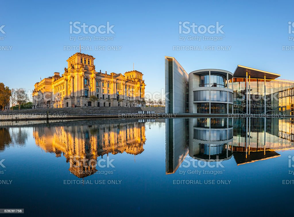 Reichstag with reflection in Spree, Berlin stock photo