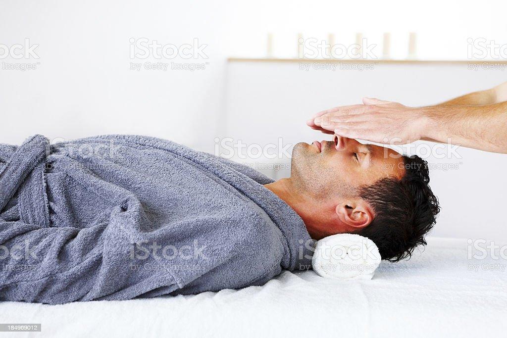 Reiki healing session at health spa stock photo