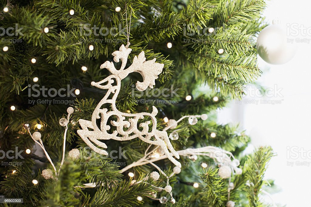 Reindeer Christmas ornament on tree stock photo