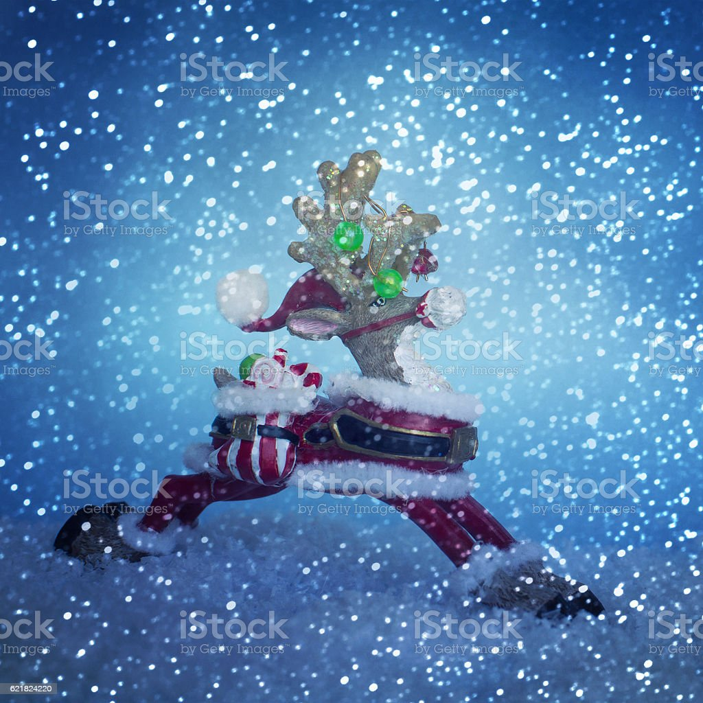 Reindeer toy. Christmas background stock photo