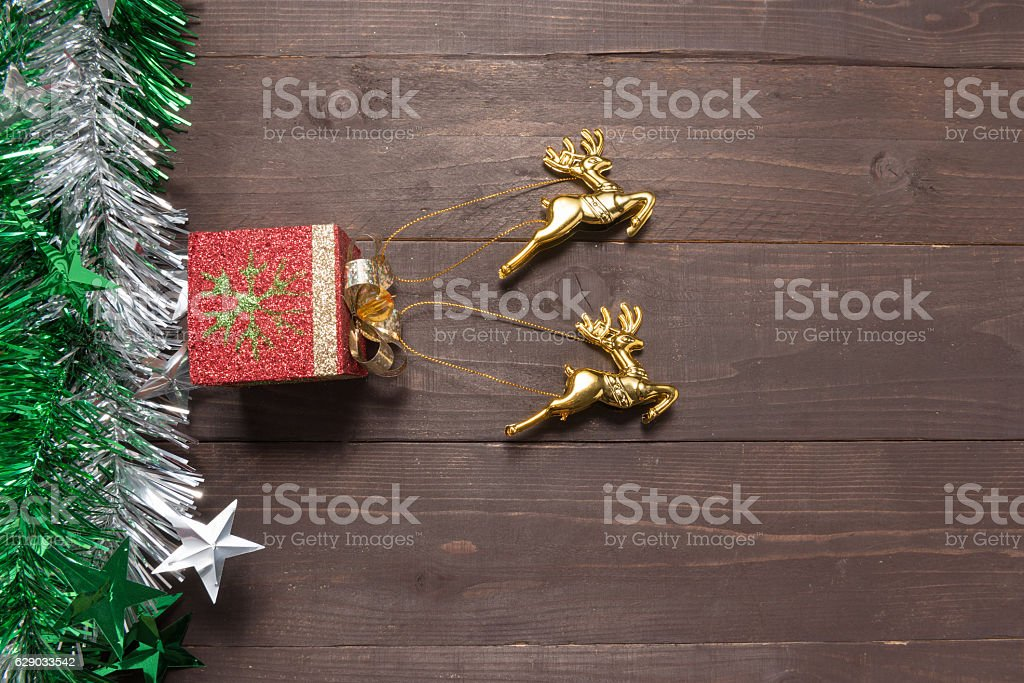 Reindeers are on on the wooden background stock photo