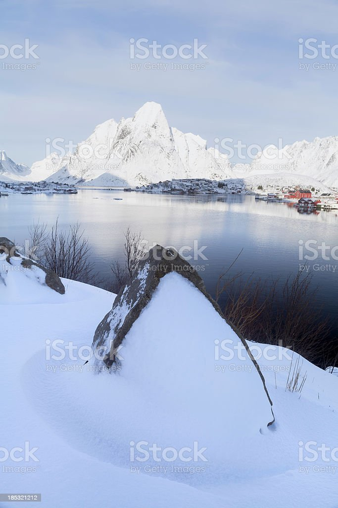 Reine, Norway with Rock and Snow royalty-free stock photo
