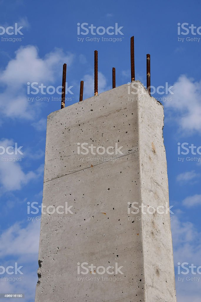 Reinforced concrete pillar against cloudy blue sky royalty-free stock photo