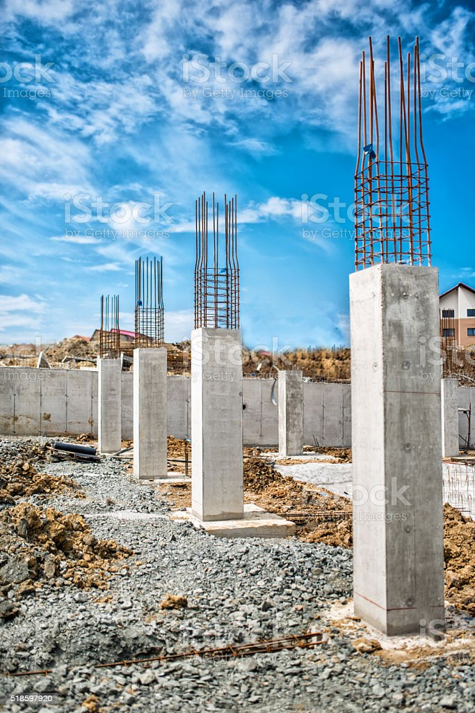 Reinforced steel bars on construction pillars, concrete details and beams stock photo