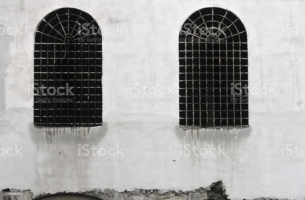 Reinforced windows - ancient fortress - Grating royalty-free stock photo