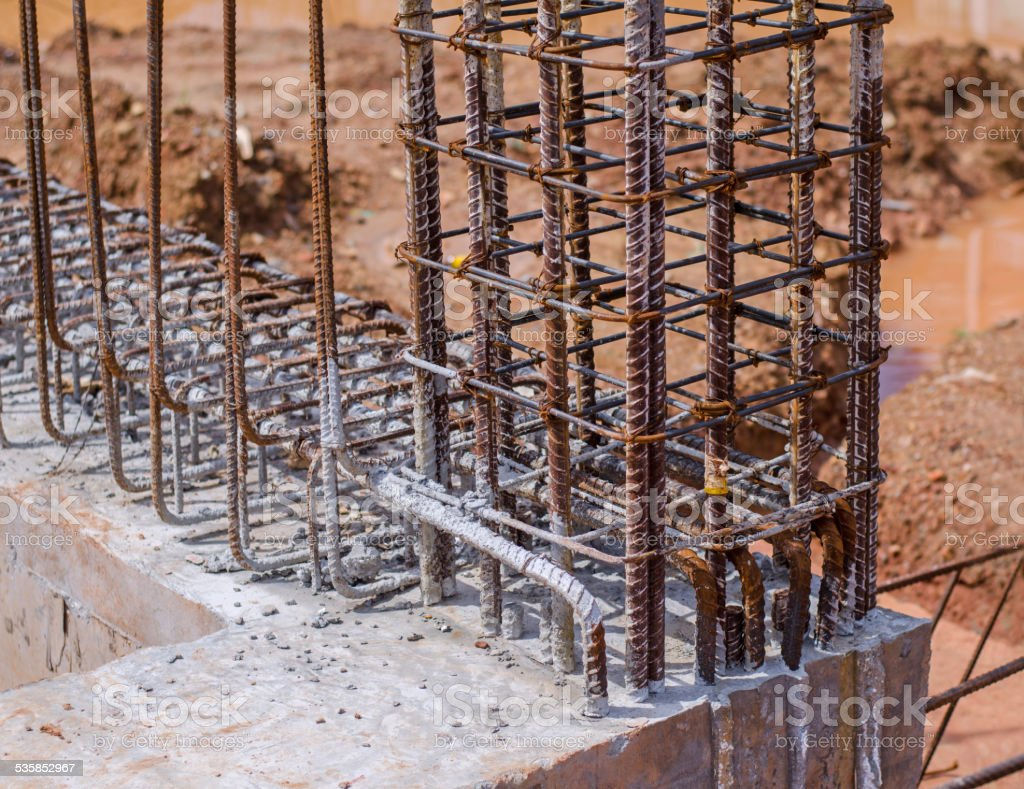 Reinforcing steel bars in construction site stock photo