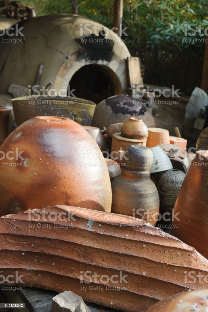 Rejects in front of kiln stock photo