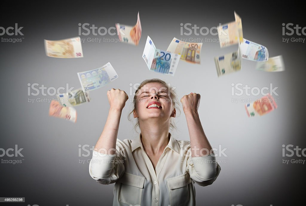 Rejoicing. Girl in white and Euro. stock photo
