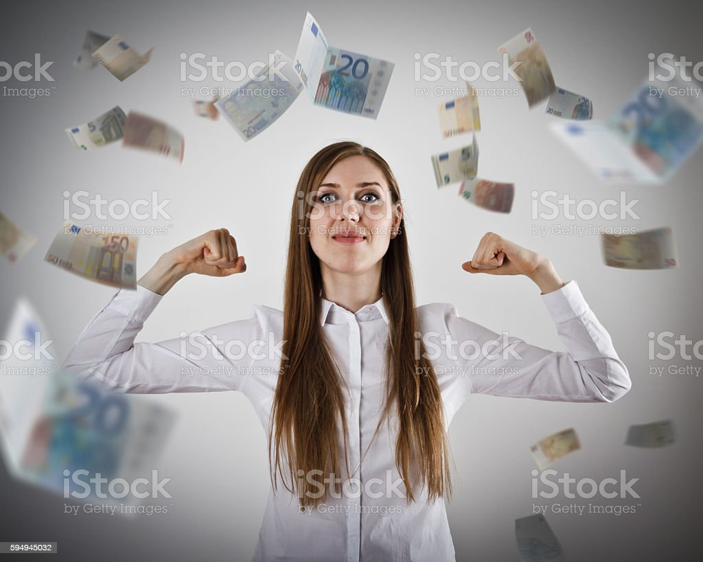 Rejoicing. Strong business woman concept. Girl in white and Euro. stock photo